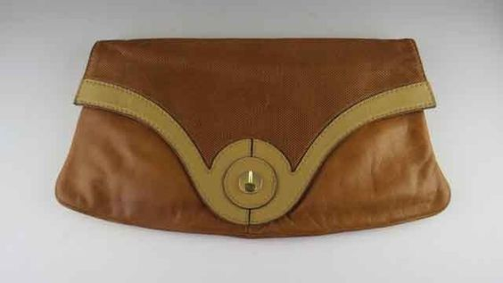 """A Large Diva envelope style purse made in Italy. The snap clasp on the flap opens to reveal one outside pocket and an inner zippered pocket. The large chamber is lined in a contrasting dark brown l... I won it!!! It's mine 14.5"""" x 8"""" so it's just the oversized clutch I've been looking for!!"""