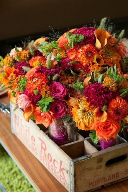 Beverage crate filled with colorful flowers