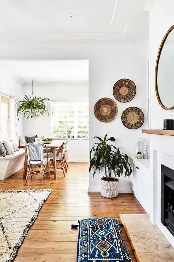 Modern boho home + White walls with natural accents + Styled with baskets on the wall | Maddie Evanett