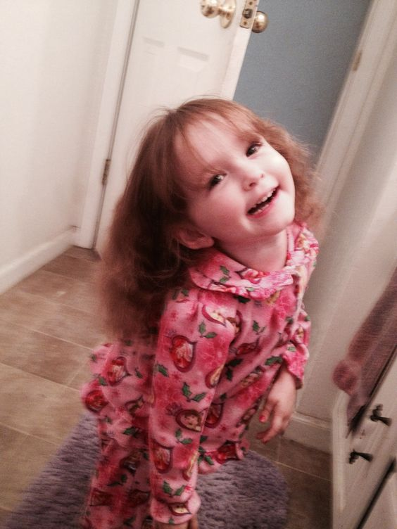 Poofy hair after pigtails. Amy strikes a giggly pose! Such a happy girl!