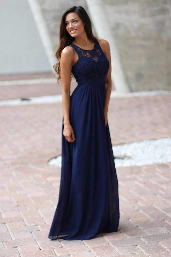 Bridesmaids Alert!!! Super elegant and cute Navy Lace Maxi Dress! Perfect for any special occasion! We love its beautiful lace flowy skirt and open back! Check out other maxi dresses at our online dress boutique!