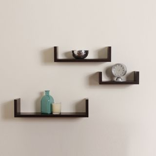 This set of 3 nesting 'U' shelves has a contemporary walnut finish, makes space utilization efficient and is the deal accent for any living space. They can be hung with the vertical sides either up or down.