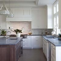 Contrast between island and cabinets.