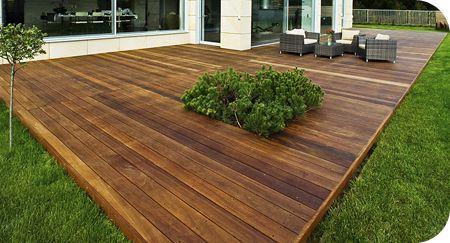 Budget ground level deck cutout backyard ideas for Pre made timber decking