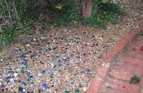 Colored Stones For Landscaping : Pea gravel mixed with colored glass stones backyard