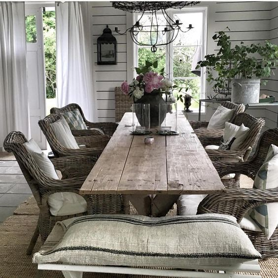 dining room with farmhouse table and wicker chairs: