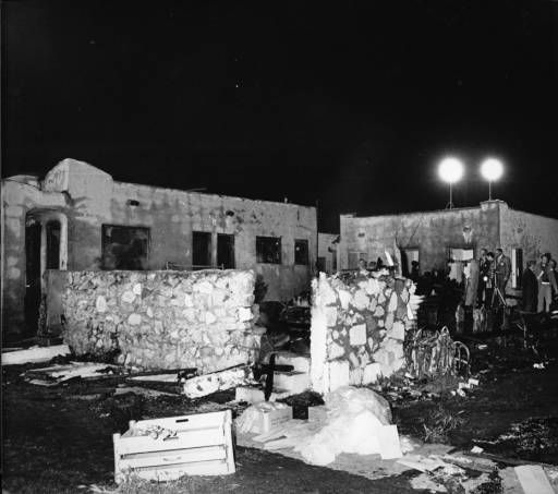 Remains of houses that caught on fire during a shootout between the domestic terrorist organization, Symbionese Liberation Army, and the Los Angeles Police Department in Los Angeles on May 17, 1974. Guy Crowder Collection. Institute for Arts and Media Photographs.