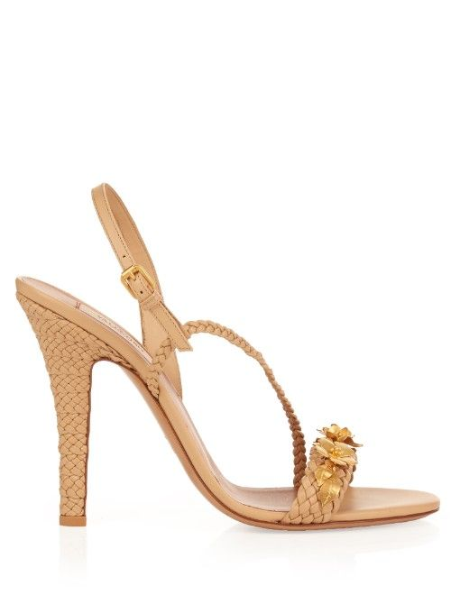 Valentino's beige calf-leather Garden Party sandals are aptly named – they're the perfect pick for sunny events. Intricate braiding covers the heel and straps, while a trim of gold-tone metal flowers adds an ornate touch. Style them with a pastel-hued dress to mirror the label's ultra-feminine styling.