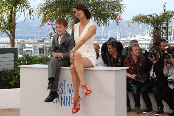 Abdul Khalim Mamatsuiev and Berenice Bejo attend 'The Search' photocall at the 67th Annual Cannes Film Festival on May 21, 2014 in Cannes, France.