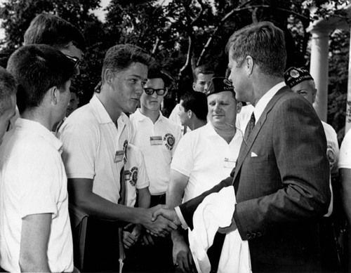A young Bill Clinton shaking hands with President Kennedy on July 24, 1963 in the Rose Garden of the White House. He was in Washington, D.C. as a delegate from Arkansas to the Boys Nation Convention. 7/24/63