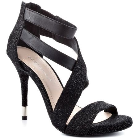 $99.99 You'll be idolized in the Ivie sandal. This #BCBGeneration #sandal delivers a #black speckled synthetic upper with wrapping #straps. A 4 1/4 inch #heel pairs with a barely there #platform for an easy and flawless strut.    Shoe Details:  #Leather Upper  Man Made Sole  Made In China  This #Shoe Fits True To Size