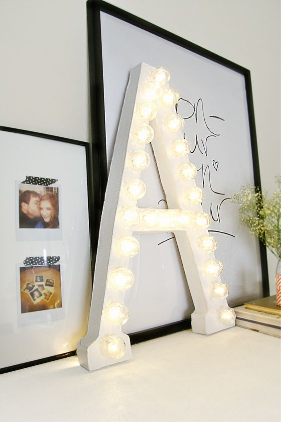 I can think of nothing else until this is made and on display in my home!! Also loving the framed Polaroids mounted with...washi?...tape. --DIY Marquee Letter by Sugar & Cloth, via Grey Likes Nesting
