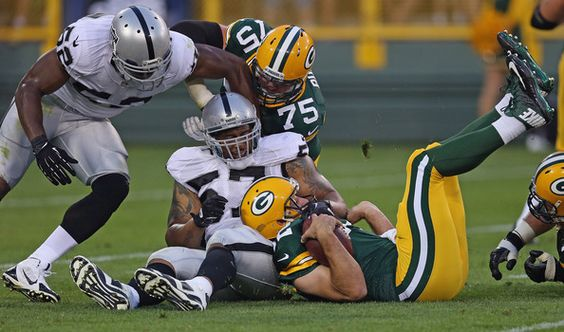 Aaron Rodgers Photos: Oakland Raiders v Green Bay Packers    Thanks for cradling Aarons head Woodley!