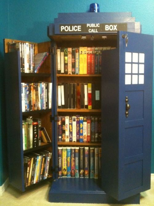 A TARDIS DVD bookshelf. It's bigger on the inside. I want one.
