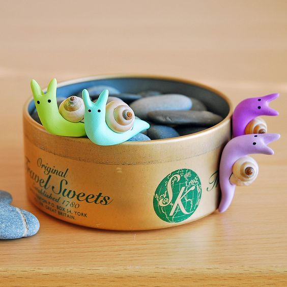 Beach snails - @Jeanette Archer I saw these and thought of Ernest! Maybe you could do some with Plasticine and shells?
