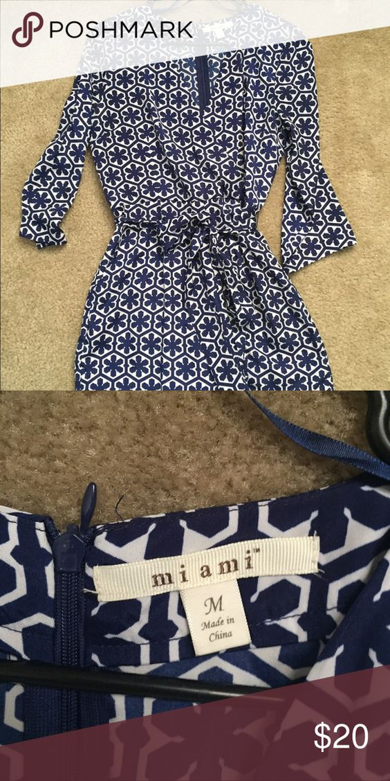 V-Neck Navy Floral Romper Adorable and trendy navy and white floral v-neck romper. EUC. Francesca's Collections Pants Jumpsuits & Rompers
