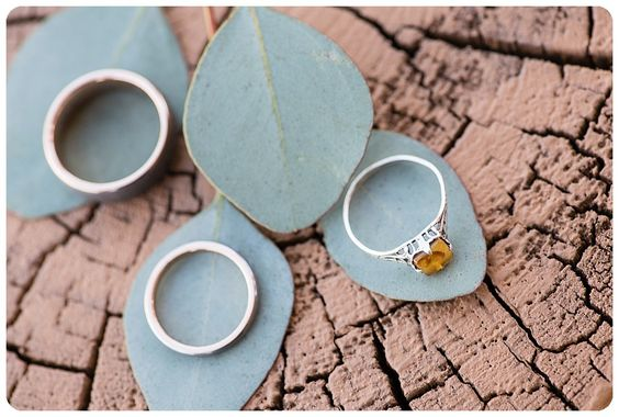 Custom wedding rings, Engagement Ring with Garnet  http://www.raynamcginnisphotography.com/sapphire-point-wedding-photographer-lauren-sean/  Unique wedding ring, engraved wedding ring, yellow wedding ring, Colorado wedding ring shot