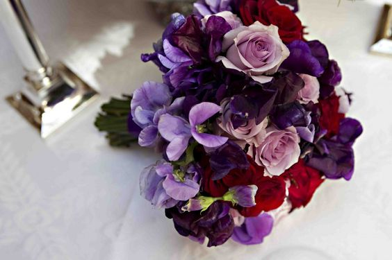 Purple and red wedding bouquet.