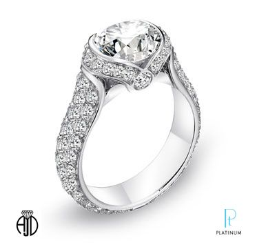 American Jewelry Designs platinum engagement ring featuring an old mine cushion cut center diamond #vintagestyle