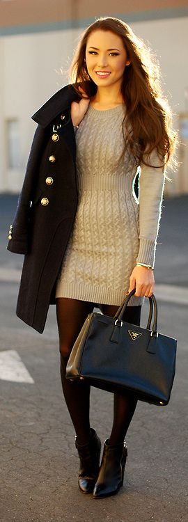 A cream sweater dress with a military coat and tights for fall.: