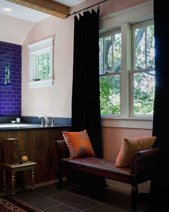 Custom made square soaker tub with wood plank surround. Leather and hobnail bathroom bench. Morocan feel accessories. Cobalt blue tiles and rustic exposed beams. #global #bathroom #morrocan #india #boho #cobalt Modern West Meets Morroco   Marcelle Guilbeau