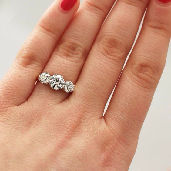 A beautiful three-stone ring, perfect for any occasion.