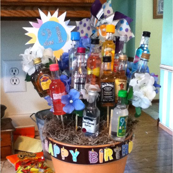 Just made this for my friends 21st. She loved it! I bought a flower pot and used styrofoam inside of it to stick the sticks that I had hot glued alcohol bottles to it. I used moss, pinwheel and fake flowers to add a little extra. And just made the 21 with scrapbook paper.