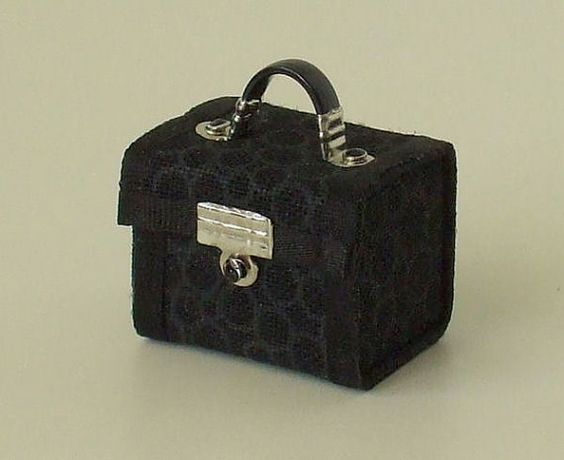 This miniature make-up box is from the same artist that makes the amazing tiny luggage. The craftsmanship is amazing. on etsy from WhimsyCottageMinis LOVE!