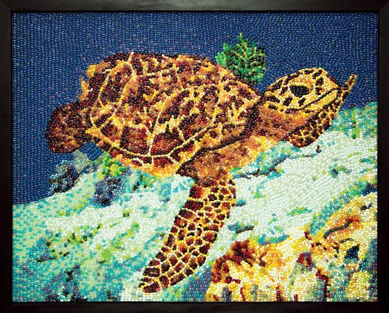 Hawksbill Sea Turtle by Kristen Cumings, 2013. Dimensions: 4 x 5 foot. A dazzling tribute to the majestic Hawksbill Sea Turtle. Found in tropical waters of the Atlantic, Pacific and Indian Oceans, this depiction finds the critically endangered turtle in a sea of Blueberry Jelly Belly beans.:
