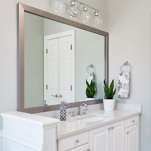 Modern Bathroom Features A Silver Mirror Frame In Broadway Brushed Chrome And Sits Atop A Modern Bathroom Mirrors Bathroom Mirror Frame Large Bathroom Mirrors
