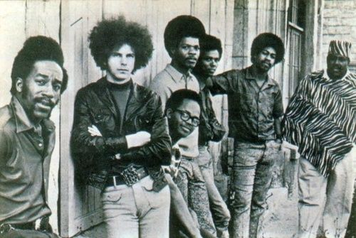 """War, 1972. War (originally called Eric Burdon and War) is an American funk band from California, known for the hit songs """"Low Rider"""", """"Spill the Wine"""", """"Summer"""", """"Why Can't We Be Friends?, """"The Cisco Kid"""", and """"The World Is a Ghetto"""". Formed in 1969, War was a musical crossover band which fused elements of rock, funk, jazz, Latin, rhythm and blues, and reggae. The band also transcended racial and cultural barriers with a multi-ethnic line-up."""