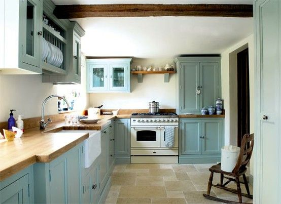 Love - Blue cabinets, butcher block counters, stone floor + dk contrasting ceiling beams ...