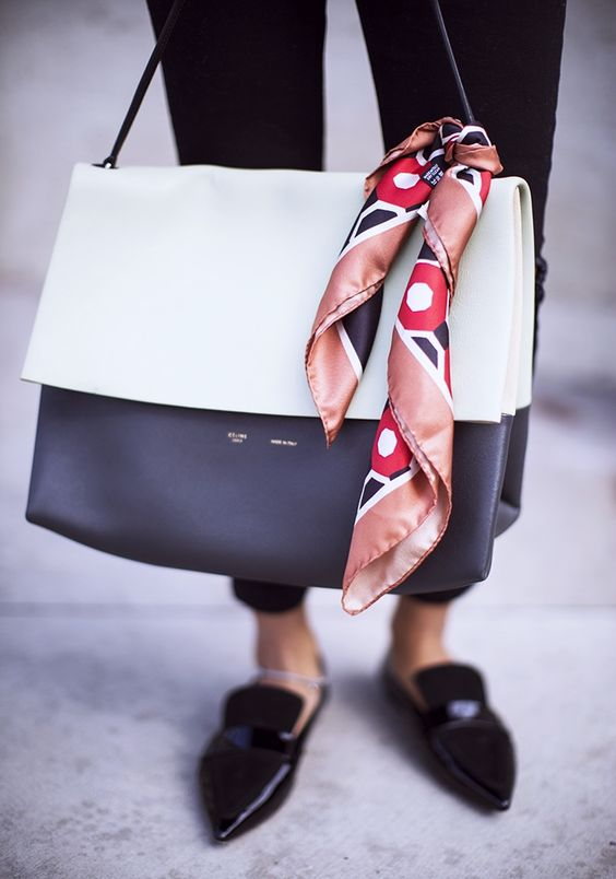 love the scarf on the bag. So awesome.
