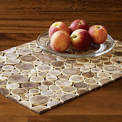 placemats made from branches. the branches are cut from trees felled to build toys for children.: