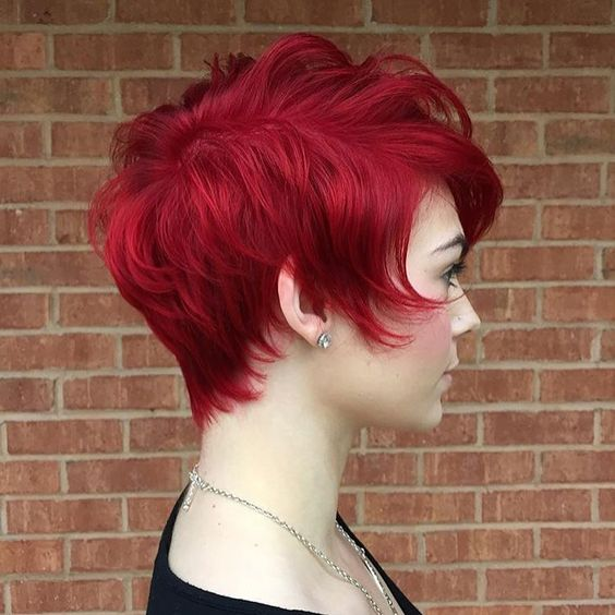 """Hot  red pixie. Color by @danielletaren, cut by @e.rene_fifthandmae #modernsalon #redhair #pixiecut"""