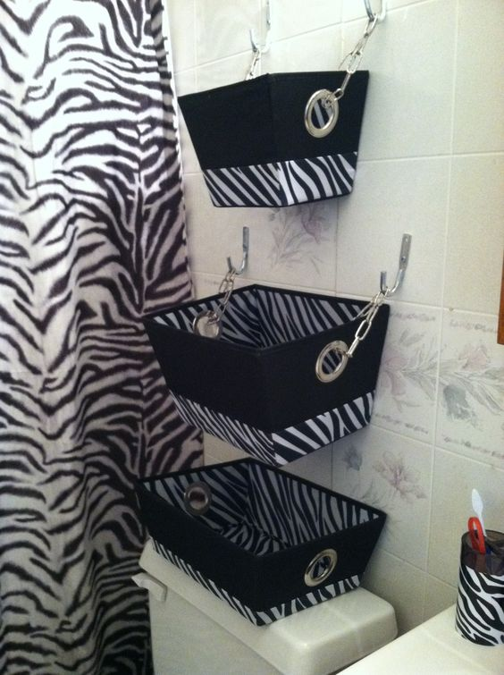 Hanging zebra print baskets for extra storage in the bathroom ...