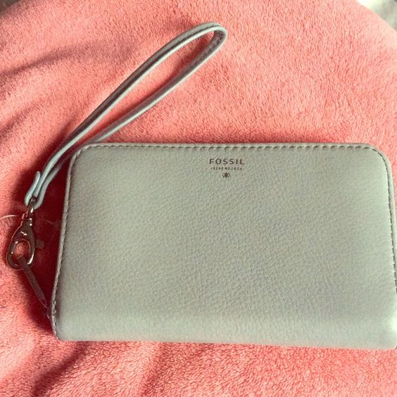 Fossil wristlet Light grey on the outside and vibrant teal on the inside! Perfect color for fall/winter. Never used, brand new and still smells like leather. Back on Poshmark because I forgot I had this listing still here  Fossil Bags Clutches & Wristlets