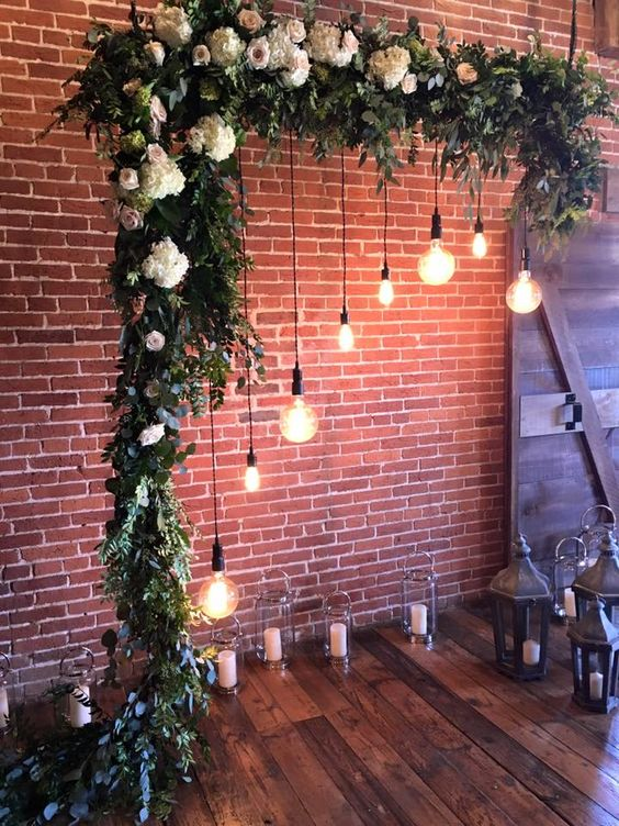 K'Mich Weddings in Philadelphia PA- wedding planning-wedding decor- arch with floral and hanging lights