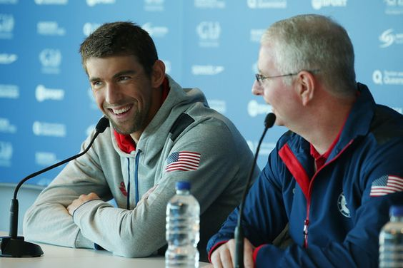 Michael Phelps Photos Photos - Michael Phelps and coach Bob Bowman speak to media during the Team USA squad press conference at the Gold Coast Aquatics Centre on August 20, 2014 in Gold Coast, Australia. - USA Pan Pacs Squad Training Session