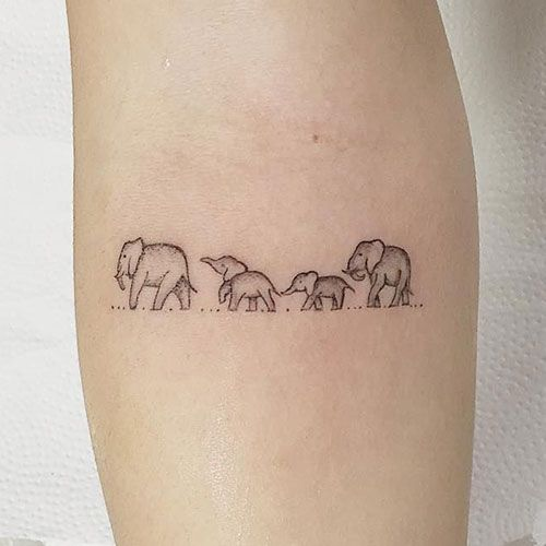 Line Of Elephants Tattoo Best Elephant Tattoos Cute Elephant Tattoo Designs And Cool Ideas Tattoos For Women Elephant Tattoo Design Simple Elephant Tattoo