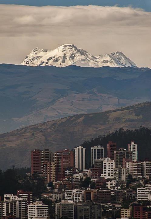 Quito with Antisana volcano. Ecuador.
