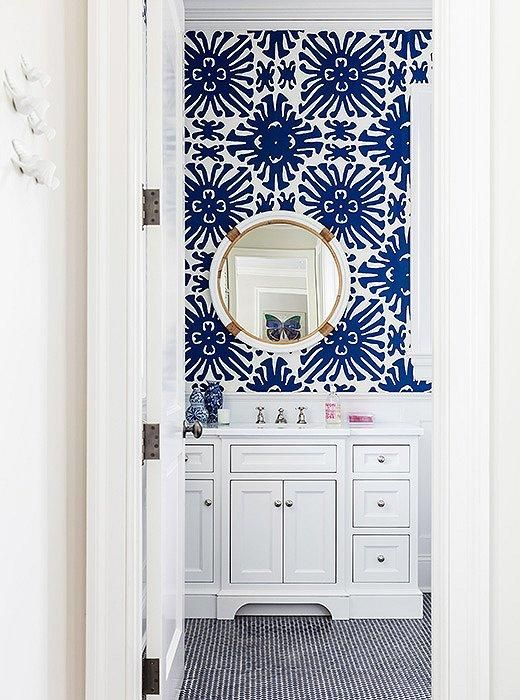 "Obsessed with the bold cobalt blue and white geometric sunburst patterned wallpaper and shiny brass and chrome accents in this adorable bathroom.  Read more on our Style Guide, ""Inside Sue De Chiara's Gorgeous Connecticut Home That's  Both Totally Traditional and Full-On Fun!"":"