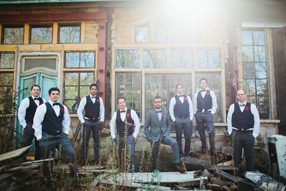 Groomsmen wearing vests + groom wearing suit combo. Photo by Geneoh.com