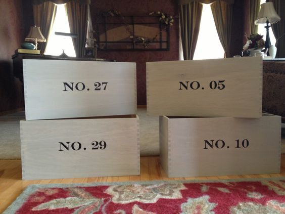 wooden custom storage crates.  I couldn't find the right size and style that I wanted for my laundry room so we made them.  Each crate sits on top of the cabinets and holds seasonal items.  The numbers on each crate represent a family member's birthday to help keep everything organized.