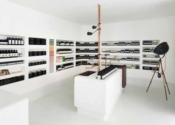 Sheets of translucent black material separate areas of this Aesop skincare store in Kyoto by Japanese studio Simplicity.