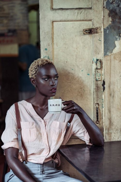 The composition of this photo is awesome, as is the contrast between her skin color and hair color.