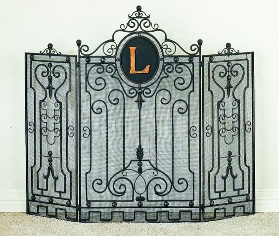 add a custom touch to your home with this  tuscan wrought iron gate design monogrammed fire