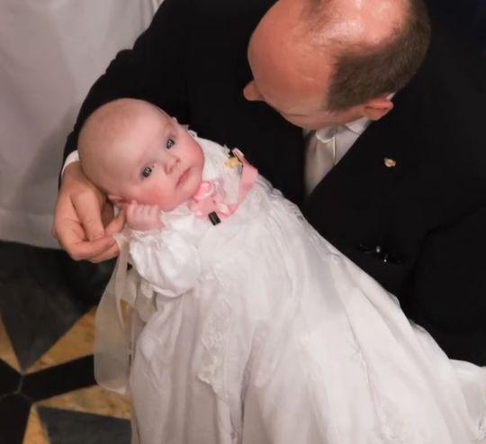 Princess Gabriella of Monaco held by her dad, Prince Albert