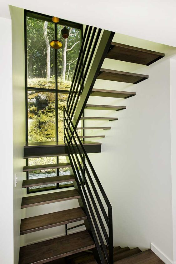 feature window at dark wood open stair tread staircase // Chalet ...