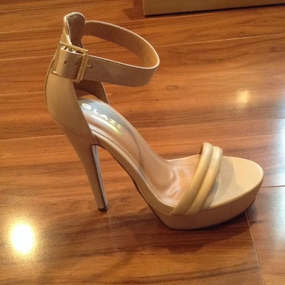 Nude heels Approx 10 inch heels with a 3 inch front platform. Worn twice, light scuff in the front.  Beige with a pink undertone. 5 1/2 but they run more like a 6. Shoes Heels